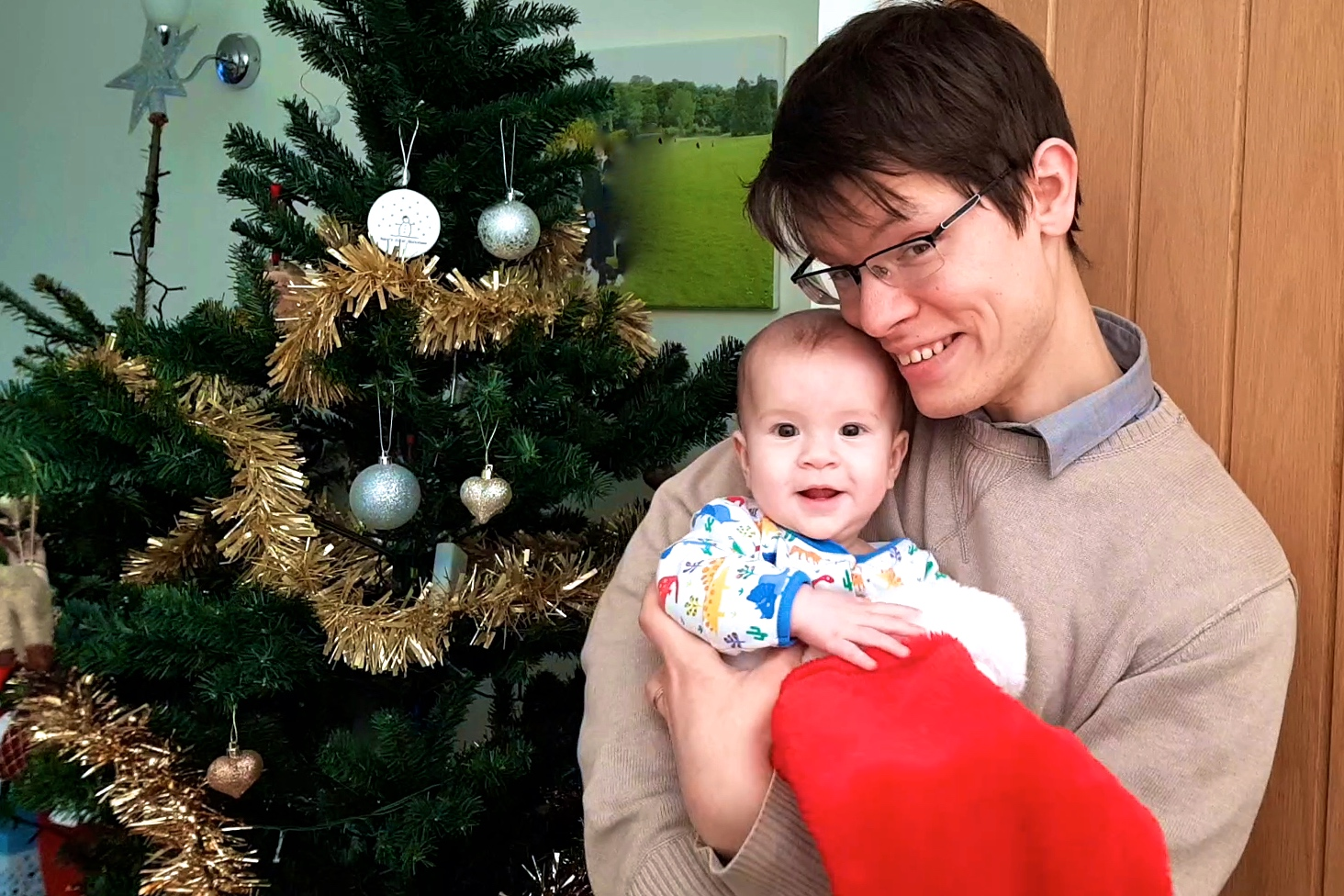 Adam and his daughter at Christmas