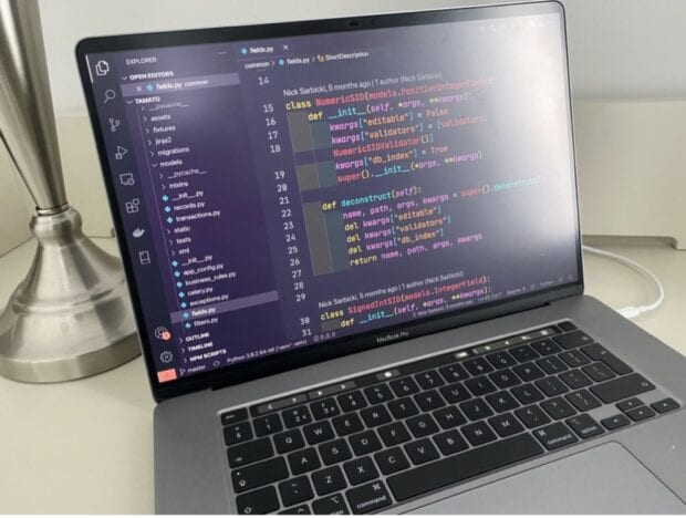 A laptop with computer code